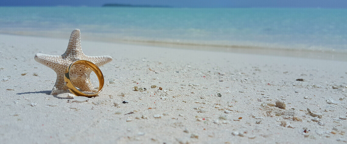 wedding band with starfish on beach