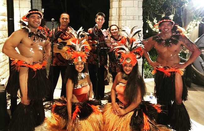 hula dancers and hawaiian musicians