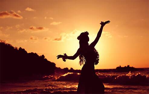 hula dancer in sunset on beach