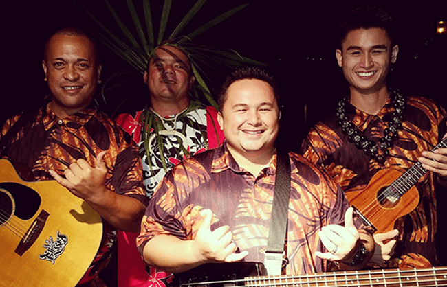 hawaiian musician band doing shaka hand sign