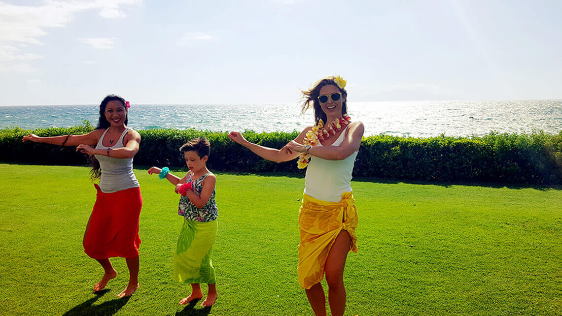 girls learning the hula on a lawn