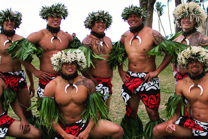 male hula dancers in traditional costume