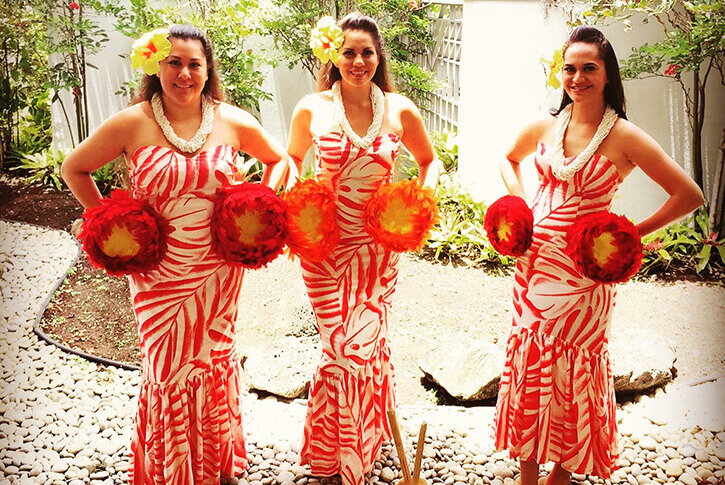 female hula dancers in traditional costume