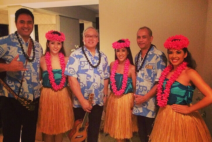 group hula dancers in traditional costume