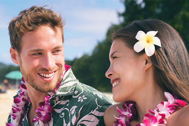 close-up of couple in hawaii wearing leis
