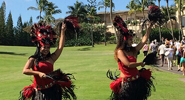 hula dancers performing outdoor on grass