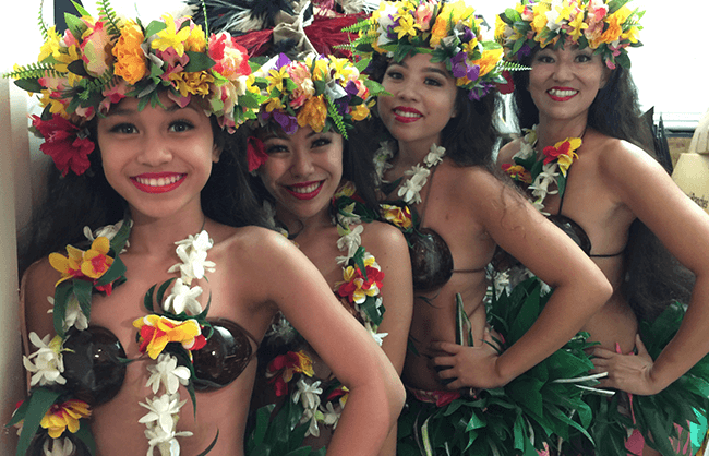 hawaiian hula dancers in traditional costumes