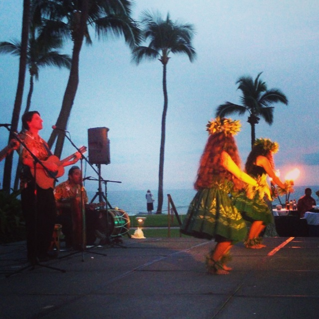 hula dancing in evening with guitar player