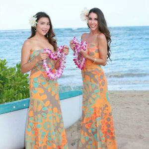 two female hula dancers with beautiful lei